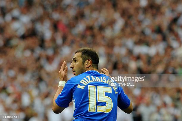 Reading's Zurab Khizanishvili reacts following a foul on Swansea City's Nathan Dyer resulting in a penalty during the 2011 Championship playoff final...