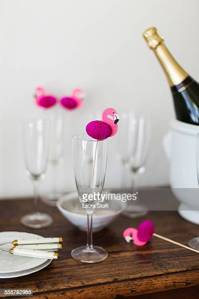 Ready for champagne toast with paper flamingos