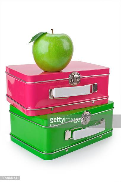 Ready for school with a shiny apple and lunchboxes