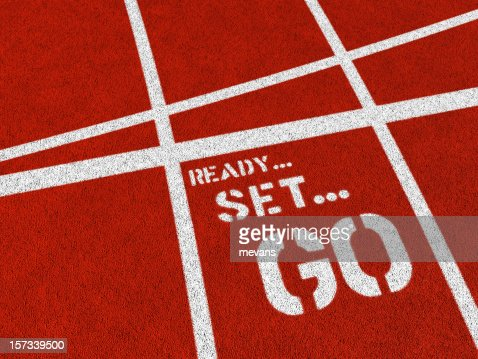 Ready set go written in white on a red track
