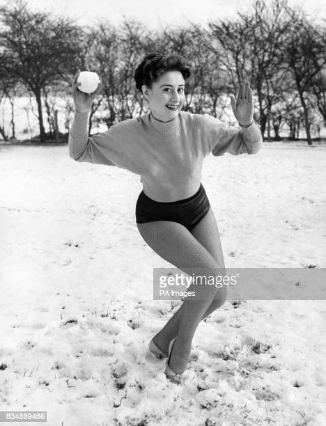 Ready to open fire is Sheila Atha of Leeds a television dancer in Manchester having fun in the snow in one of Manchester's parks between rehearsals