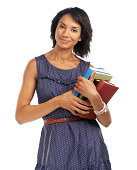Portrait of a woman holding a pile of books