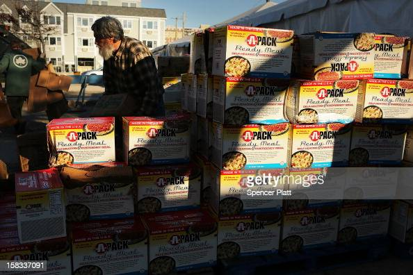 Readytoeat meals are stacked up outside of a relief station near the beach in Rockaway on December 13 2012 in New York City Much of the Rockaway...