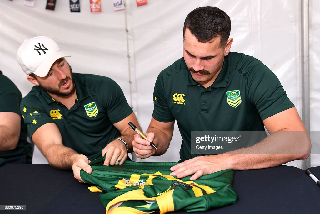 Reagan Campbell-Gillard and Ben Hunt sign autographs during an Australia Kangaroos and England Signing Session at Reddacliff Place on November 28, 2017 in Brisbane, Australia.