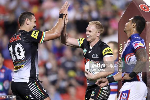 Reagan CampbellGillard and Peter Wallace of the Panthers celebrate scoring a try during the round four NRL match between the Penrith Panthers and the...