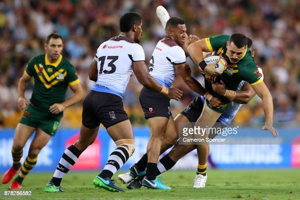 Reagan CampbellGillard of the Kangaroos is tackled during the 2017 Rugby League World Cup Semi Final match between the Australian Kangaroos and Fiji...