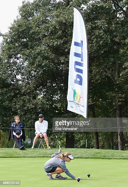 Reagan Kennedy lines up her putt in the girls 1011 putting competition during the 2015 Drive Chip and Putt Tournament at Medinah Country Club on...