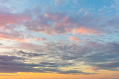 Real background of majestic sunrise sky with gentle colors of soft clouds, big size