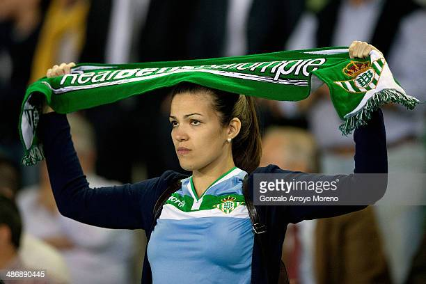 Real Betis Balompie fan holds up a scarf prior to the start the La Liga match between Real Betis Balompie and Real Sociedad de Futbol at Estadio...