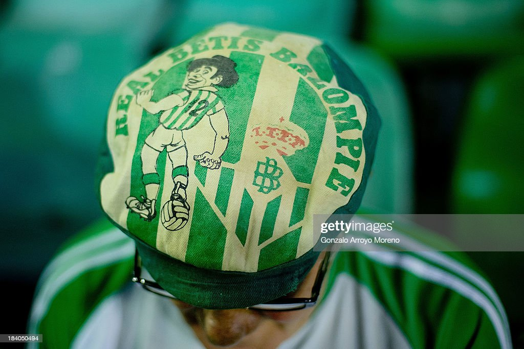 A Real Betis Balompie fan with an old club«s soft cap prior to start the La Liga match between Real Betis Balompie and Villarreal CF at Estadio Benito Villamarin on September 29, 2013 in Seville, Spain.