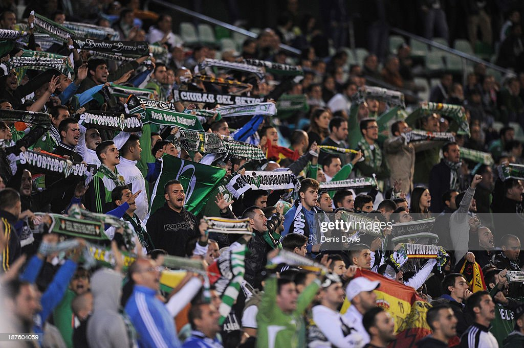 Real Betis Balompie fans cheer on their team during the La Liga match between Real Betis Balompie and FC Barcelona at Estadio Benito Villamarin on...