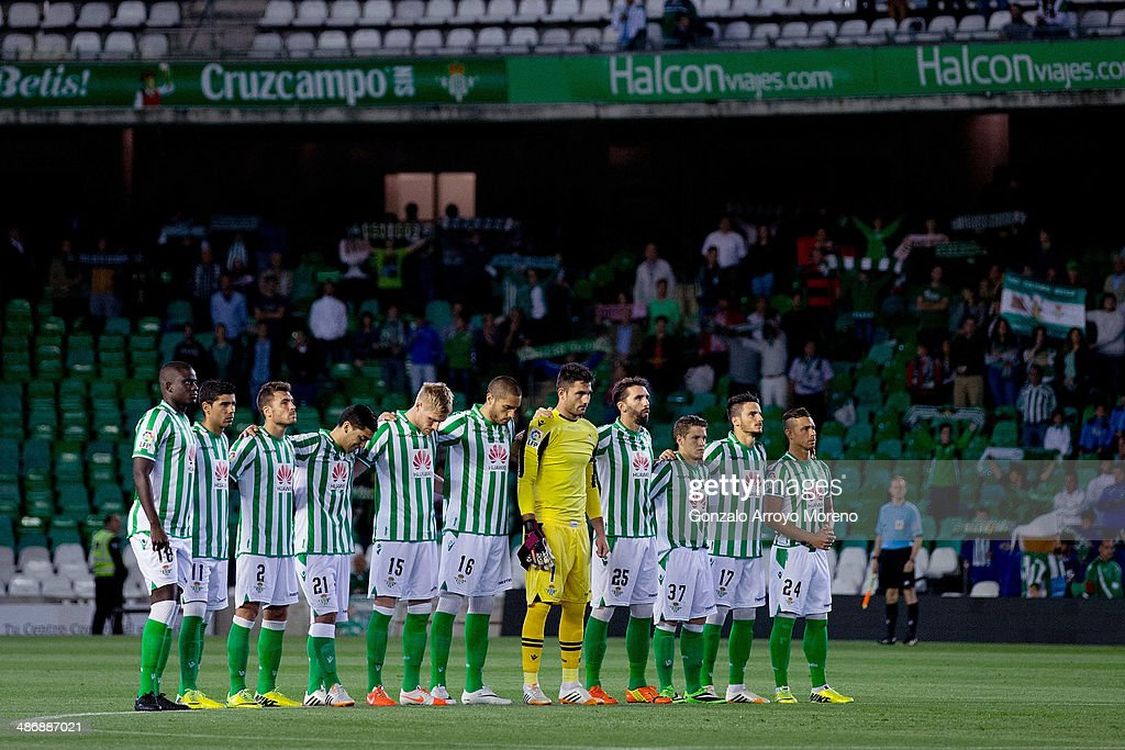 Real Betis Balompie players observe one minute of silence in honor of ex Barcelona FC head coach Tito Vilanova prior to start the La Liga match...