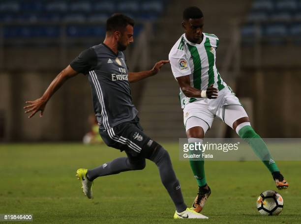 Real Betis defender Junior Firpo with Benfica's midfielder Andreas Samaris from Greece in action during the Algarve Cup match between SL Benfica and...