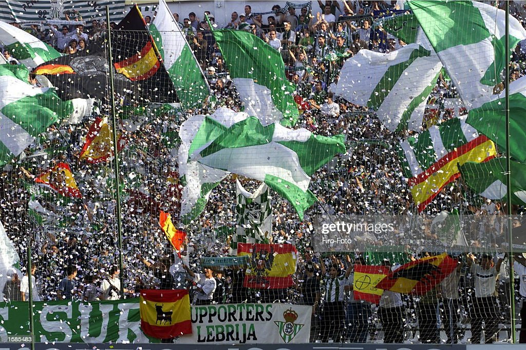 Real Betis fans wave flags during the Real Betis v Malaga La Liga match played at the Ramon Sanchez Pizjuan Stadium on November 3 2002 in Seville...