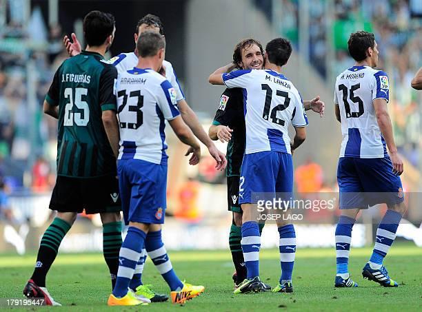 Real Betis' midfielder Joan Verdu hugs with Espanyol's forward Manolo Lanzarote during the Spanish league football match RCD Espanyol vs Betis on...