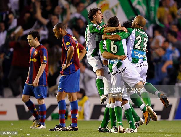 Real Betis players celebrate after scoring their second goal against Barcelona during the La Liga match between Real Betis and Barcelona at the...
