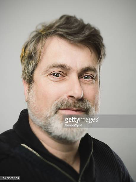 Real caucasian mature adult man portrait with happy expression