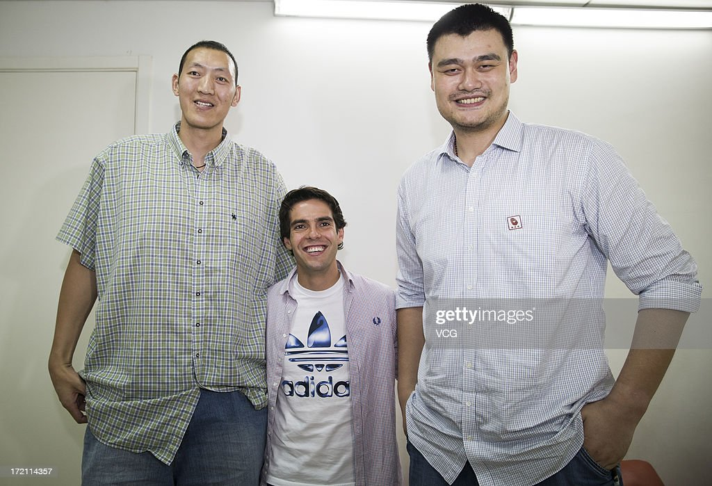 Real (L - R) Chinese basketball player Sun Mingming, Madrid's Brazilian midfielder Kaka and former NBA star <a gi-track='captionPersonalityLinkClicked' href=/galleries/search?phrase=Yao+Ming&family=editorial&specificpeople=201476 ng-click='$event.stopPropagation()'>Yao Ming</a> attend the 2013 Yao Foundation Charity Game between China and the NBA Stars at MasterCard Center on July 1, 2013 in Beijing, China.
