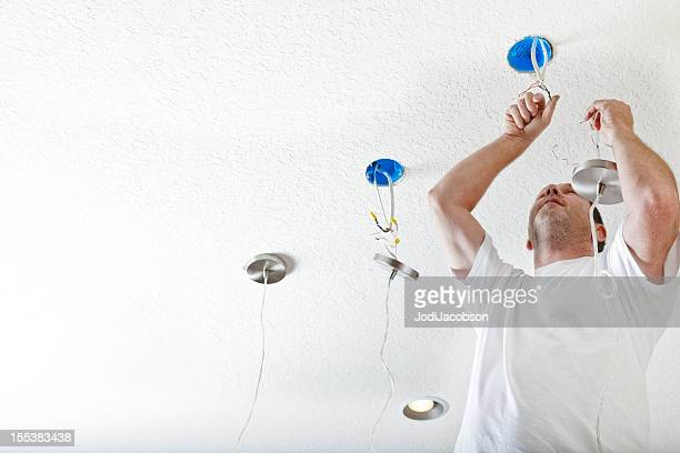Real Electrician hanging fixtures