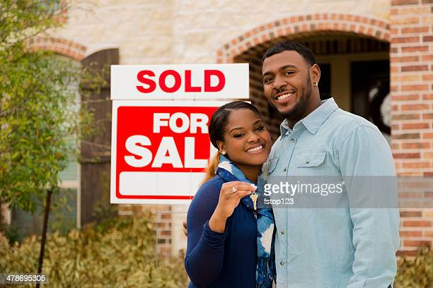 Real Estate: African descent couple buys first home. House key.