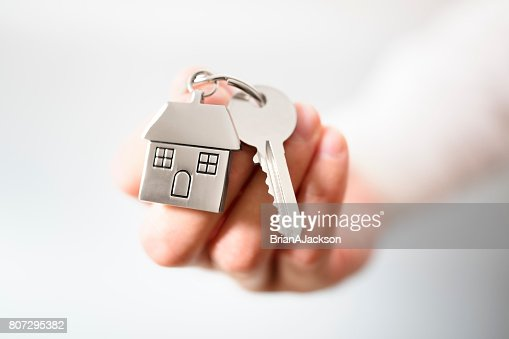 Real estate agent giving house keys : Stock Photo