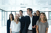 Real estate agent giving tour to business people in new office