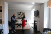 Real estate agent Katie Hayes answers questions about a home for sale during an open house on May 28 2013 in San Francisco California According to...