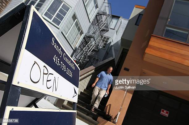 A real estate agent leaves an open house for a home for sale May 4 2010 in San Francisco California The National Association of Realtors reported...