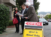 Real estate agent Maurice Dolan hands out information on a home for sale during an open house on July 30 2013 in San Francisco California According...