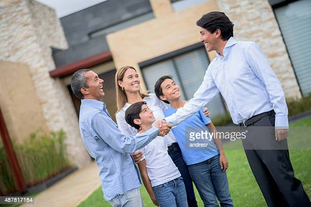 Real estate agent selling house to a family