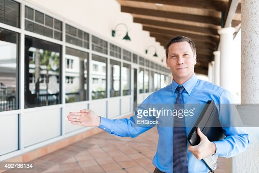 Real Estate Agent Showing Property