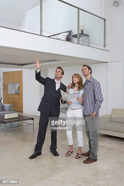 Real Estate Agent with Clients in New Home