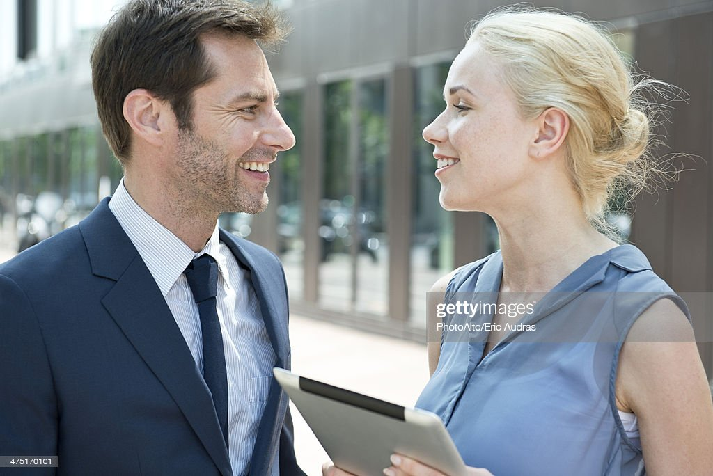 Real estate agent with digital tablet meeting with potential buyer : Stock Photo