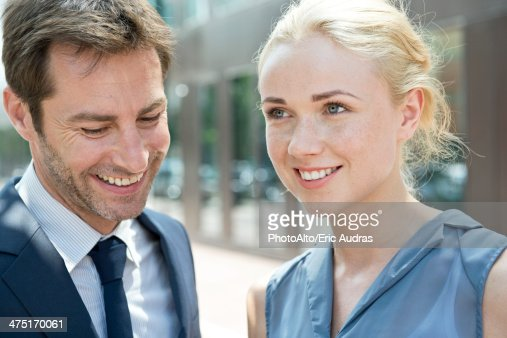 Real estate agent with potential buyer : Stock Photo