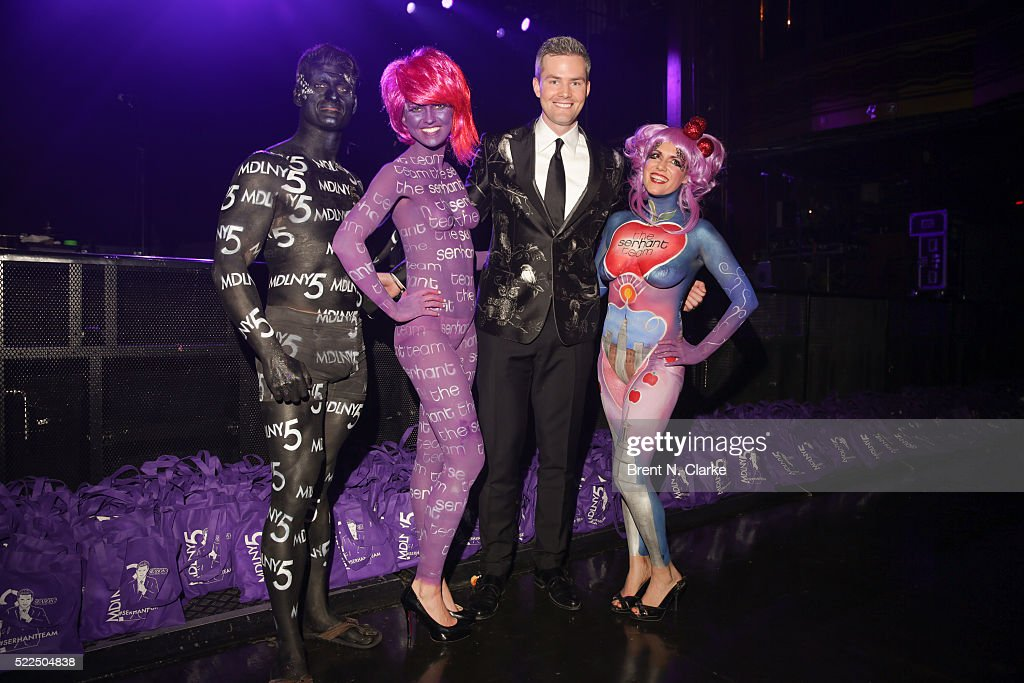 Real estate agent/reality television star Ryan Serhant poses for photographs with event performers painted by Trina Merry Studios during the Season 5...