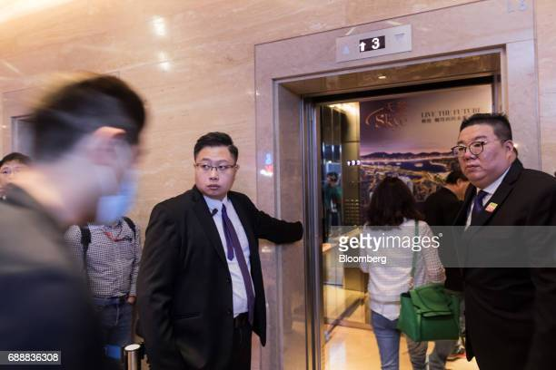 Real estate agents and potential buyers enter an elevator to the sales office of the Victoria Skye residential development developed by KK Property...