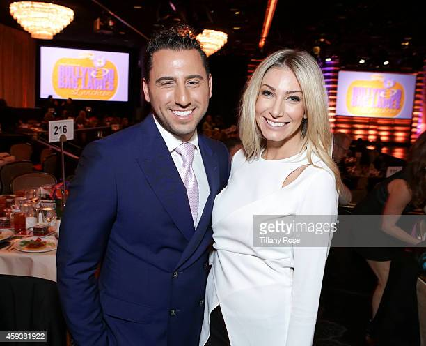 Real estate agents Josh Altman and Heather Bilyeu attend the Lupus LA Hollywood Bag Ladies Luncheon on November 21 2014 in Beverly Hills California