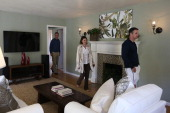 Real estate agents tour a home for sale during an open house on February 21 2013 in San Anselmo California According to the National Association of...
