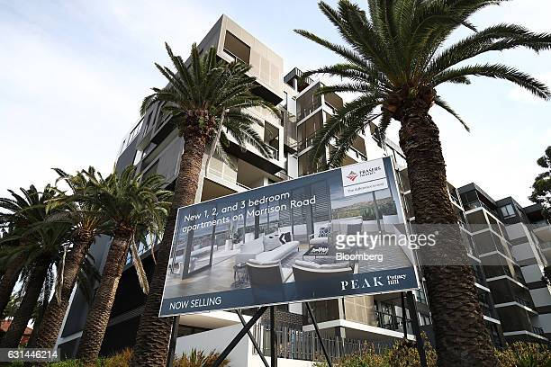 A real estate billboard stands in front of newly constructed apartments in the suburb of Putney Hill in Sydney Australia on Sunday Jan 8 2017...