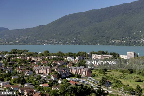Real estate buildings and houses on the lakeside in AixlesBains general view of AixlesBains and Lake Bourget from the upper city