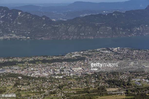Real estate buildings and houses on the lakeside in AixlesBains general view of AixlesBains and Lake Bourget from the Revard Mount
