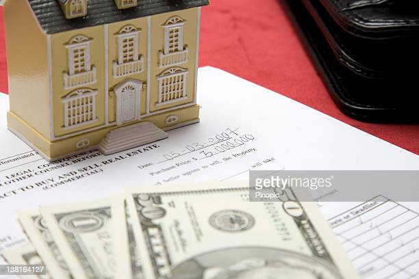 Real Estate contract, house and dollars