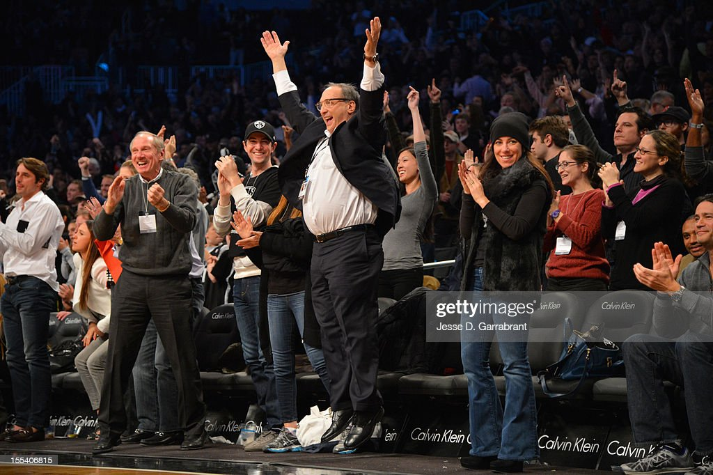 Real Estate Developer and Minority Owner Bruce Ratner of the Brooklyn Nets celebrates the win against the Toronto Raptors during the first ever regular home season game at the Barclays Center on November 3, 2012 in the Brooklyn borough of New York City.