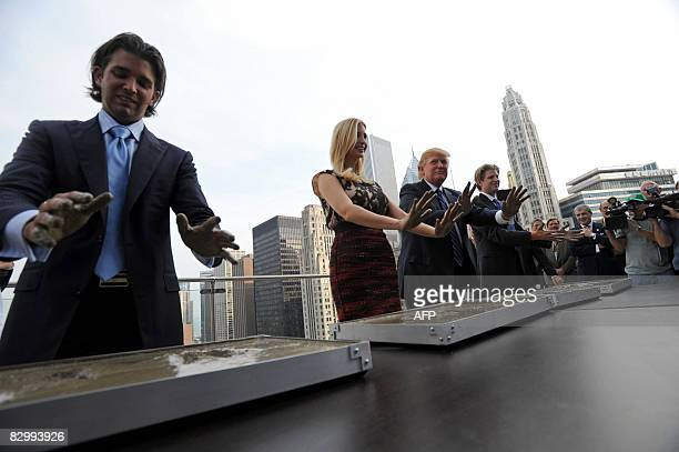 Real estate developer Donald Trump and his children Donald Jr Ivanka and Eric make hand prints during during a press conference at the Trump...