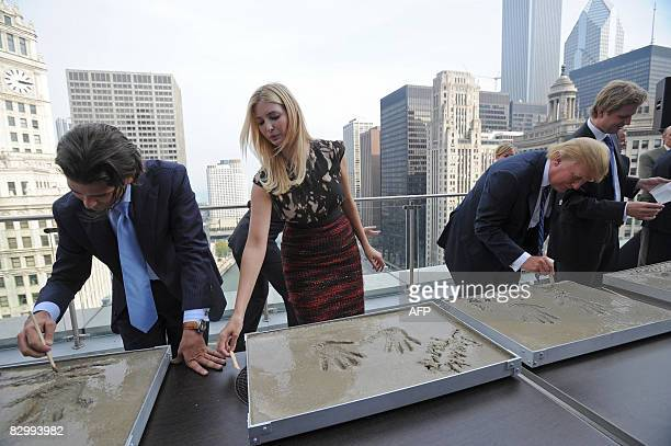 Real estate developer Donald Trump and his children Donald Jr Ivanka and Eric write their name in cement after making hand prints to inaugurate their...
