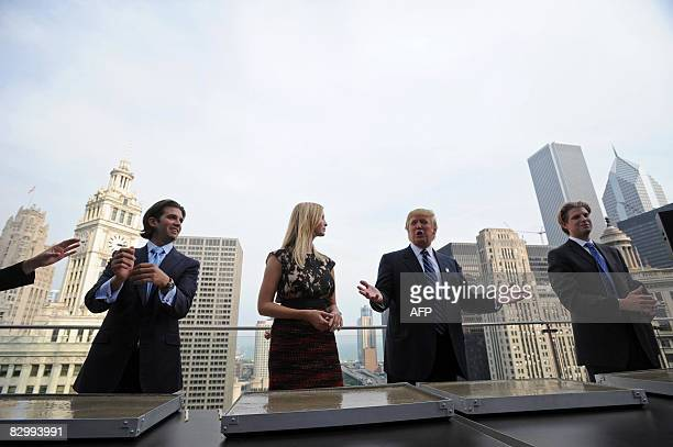Real estate developer Donald Trump and his children Donald Jr Ivanka and Eric prepare to make hand prints during a press conference at the Trump...