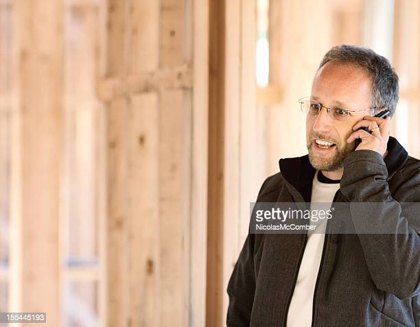 Real estate developer on the phone at construction site