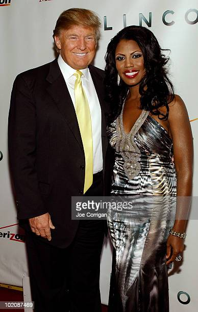 Real estate developer/TV personality Donald Trump and TV personality Omarosa attend 'The Ultimate Merger' premiere at Trump Tower on June 14 2010 in...