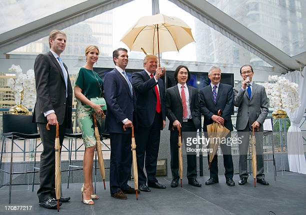 Real estate investor Donald Trump center stands for a photograph with Eric Trump from left Ivanka Trump Donald Trump Jr Joo Kim Tiah chief executive...