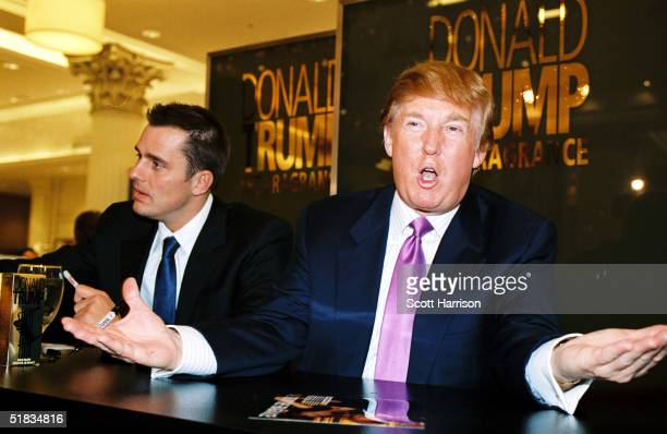 Real estate mogul Donald Trump and 'The Apprentice' winner Bill Rancic make a promotional appearance at Marshall Field's for Trump's new cologne The...